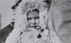 Young child wearing the traditional rabbit fur coat