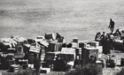 Cree men loading crates off a barge