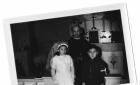 Church missionary baptizing Cree children