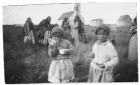 Cree girls eating bannock and drinking tea